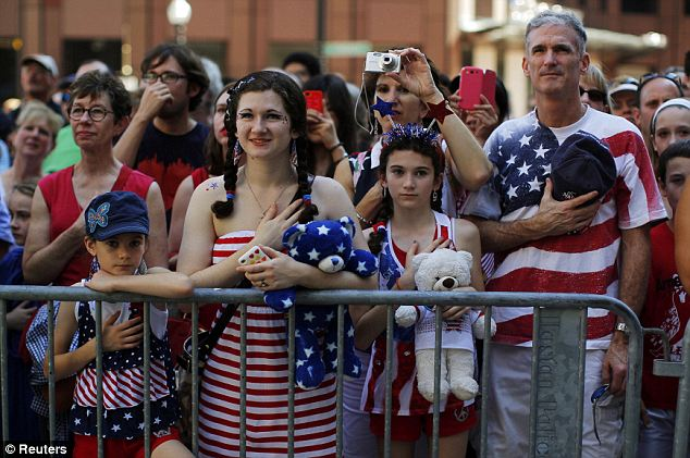 Bringing families together: The Haigs stand and pledge allegiance at a public reading of the Declaration of Independence in Boston