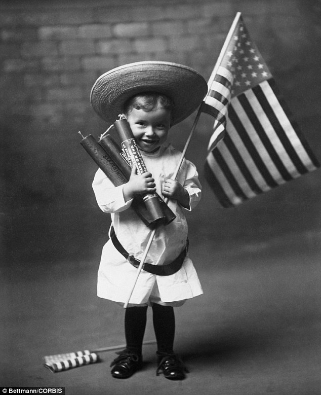 Fire cracker: This little child looks excited by the promise of a fireworks display in 1906