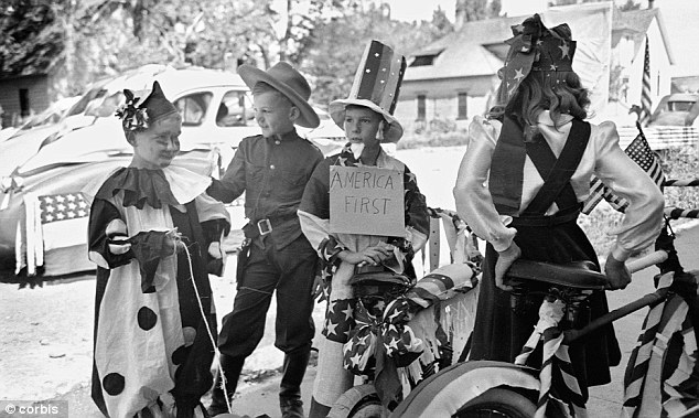 Dressed up: Uncle Sam and cowboy costumes are popular choices for this 1941 parade in Vale, Oregon