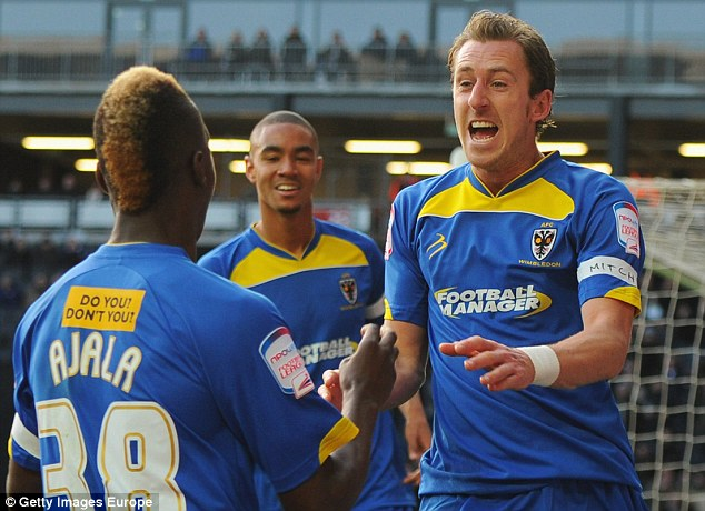 Local boys: The All England Club have included AFC Wimbledon on the guest list for the Royal Box