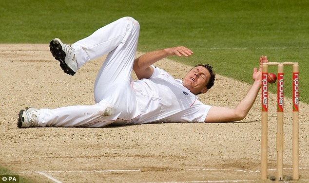 England's Darren Pattinson lies on the pitch after failing to catch out South Africa's Mark Boucher