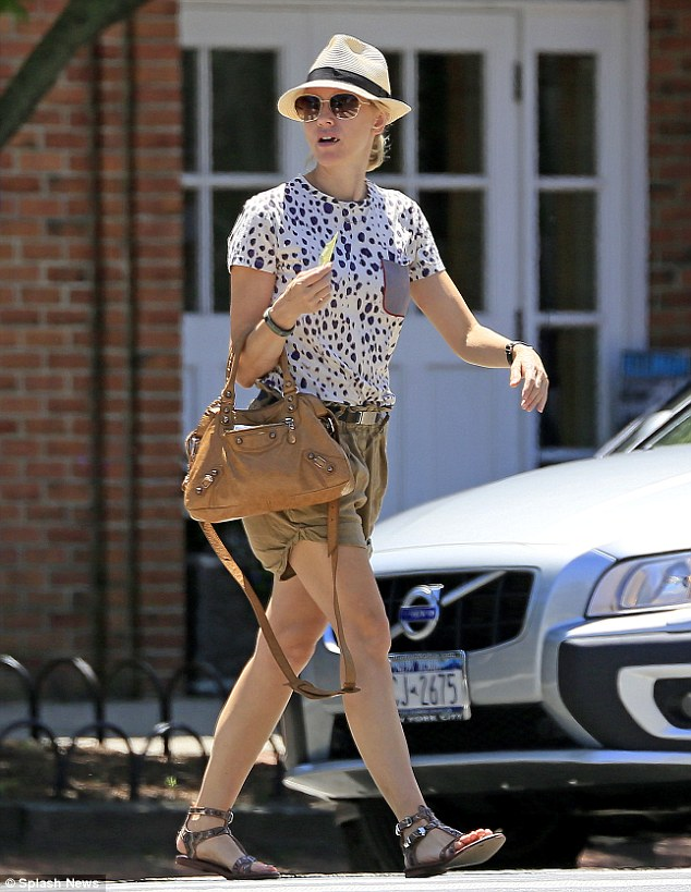 Needs reminding: Naomi Watts stepped out solo on Thursday with a yellow list of things to do ahead of her family's Fourth Of July celebration in The Hamptons
