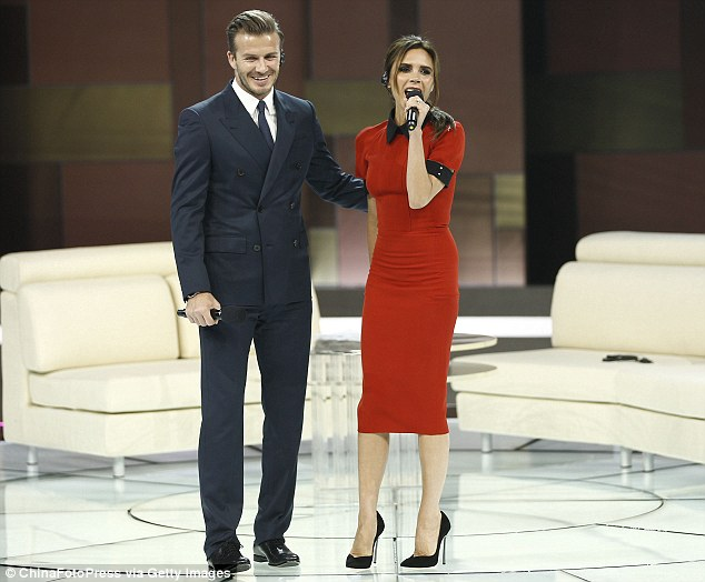 Expanding Brand Beckham: Victoria and her husband David appearing on the China Central TV show in Beijing on June 23