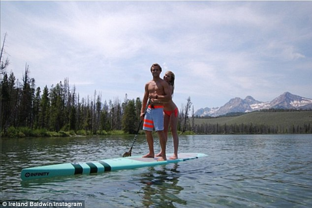 Feeling festive! Ireland Baldwin posted a picture on Thursday of herself paddleboarding with boyfriend Slater Trout in Idaho