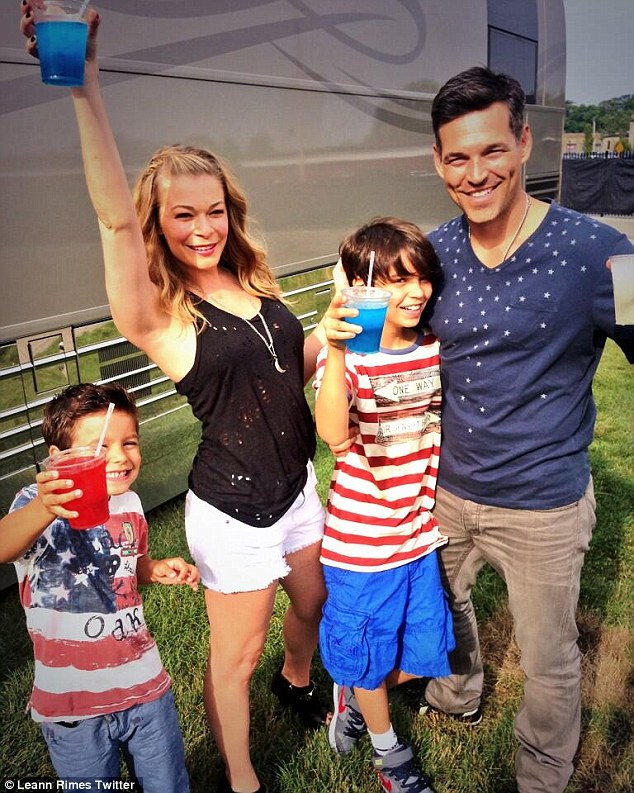 'From our family to yours!' Meanwhile her two boys spent July 4th with Eddie and his wife LeAnn Rimes in Michigan where the two-time Grammy winner had a Muskegon gig