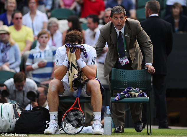 Head in hands: Murray reacts as the decision was made to close the roof