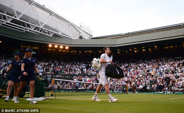 Off you go: Murray leaves Centre Court