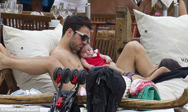 That's better: Lia was later seen looking calmer as she cuddled up to her father