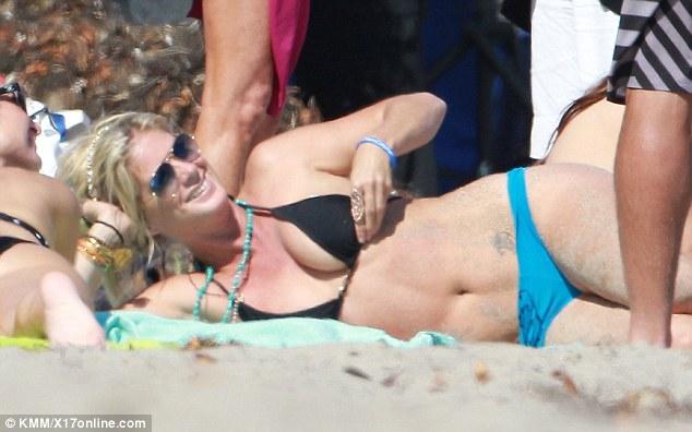 Rachel Hunter shows off tattoo bikini body on the beack and looking good