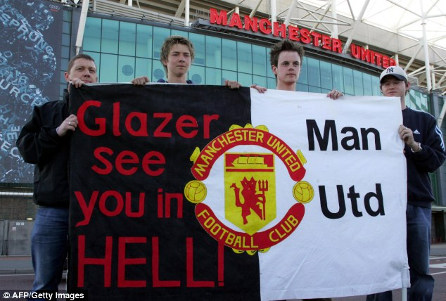 Manchester United fans demonstrating at Old Trafford, after US tycoon Malcolm Glazer
