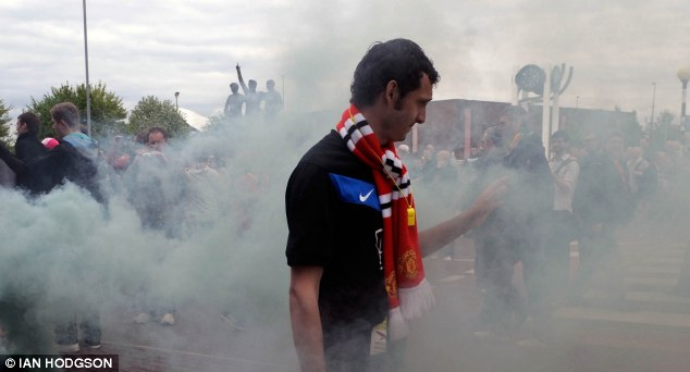 MANCHESTER UNITED V STOKE - Man Utd fans let off a smoke bomb in protest at the Glazers.