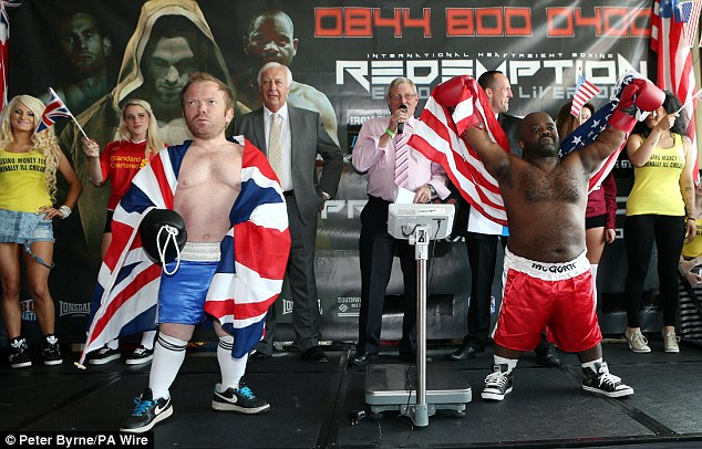 Battle: Mini David Price and mini Tony Thompson pose for the crowd at the weigh-in