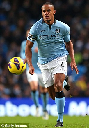 Vincent Kompany in action for Man City