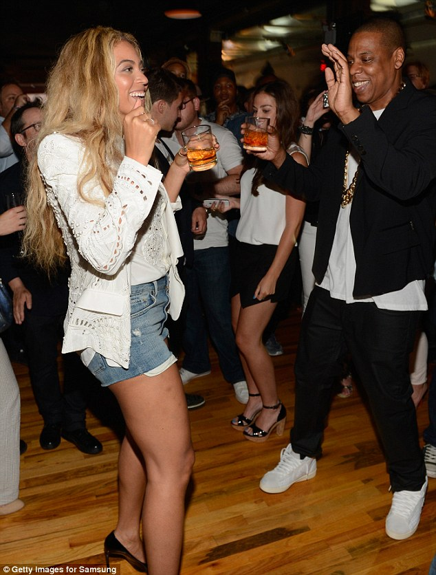 Party time: The couple were seen sipping on a drink that appeared to be cognac and ice