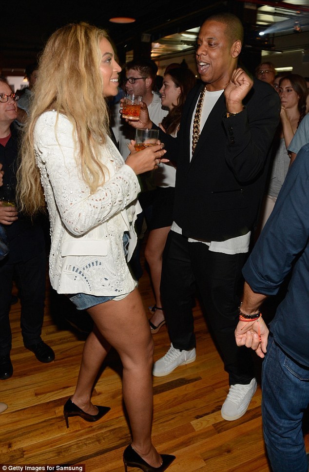Let's groove B! Jay-Z and Beyonce were seen dancing up a storm at the rapper's album release party in Brooklyn, New York, on Wednesday night
