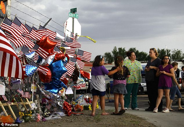 Tribute: Residents built a memorial to the 19 firefighters in Prescott, Arizona