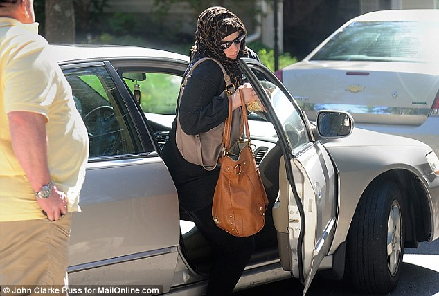 Widow: Katherine Russell is pictured three days after her husband was killed following a police shootout. Sources say she has now backed away from their Muslim beliefs and uses her maiden name