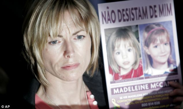 Kate McCann, Madeleine's mother, holding a picture of her daughter in 2010 in one of her many appeals for information