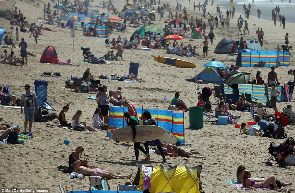 Sunbathe: Sun worshipers took to the beach yesterday in Newquay