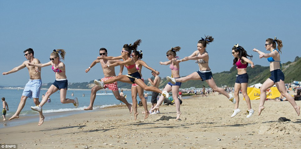 Jumping for joy: Forecasters said today has been the hottest day of the year so far