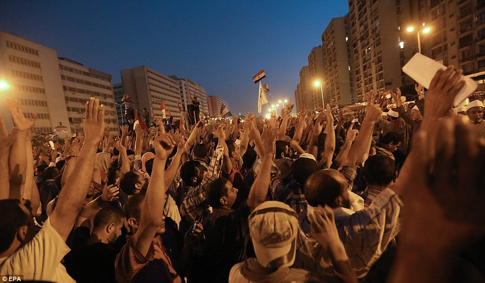 Fervour: Morsi's backers congregated next to the headquarters of the Republican Guard in the Egyptian capital last night