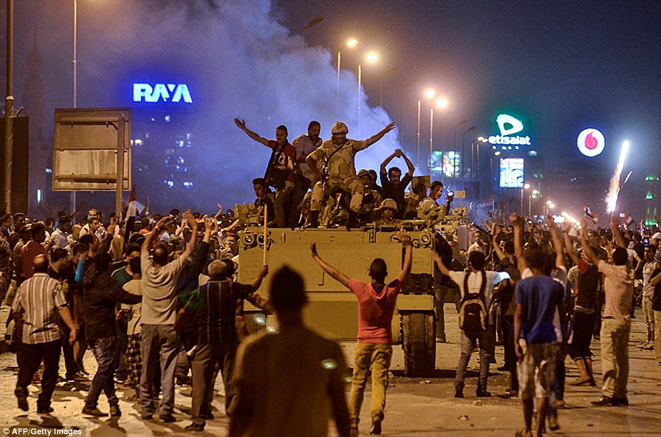 Fury: Thousands of Morsi's Islamist supporters had flooded the area to demand the ousted president be reinstated