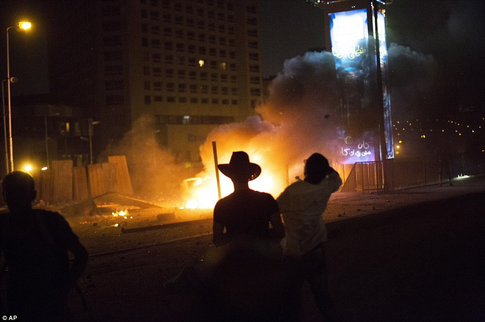 Flames: The capital of Egypt was witness to chaotic scenes over night as supporters of the ousted president took to the streets to demonstrate their anger at the military coup