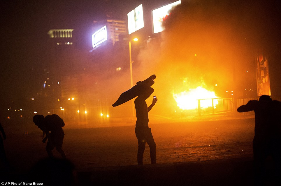 Violence has continued into the night as supporters or Morsi clash with opponents of the former dictator