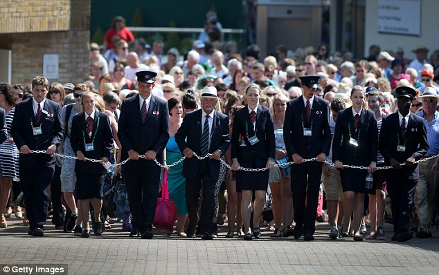 Open the gates: Security guards let spectators into the grounds on day 12 of The Championships