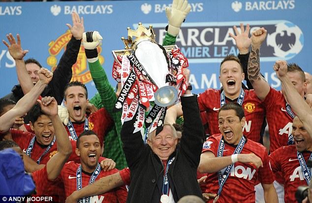Title winner: Ferguson holds aloft the Premier League trophy last season