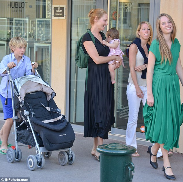 Proud mum: Uma enjoys a sunny family holiday with her three children in Saint-Tropez