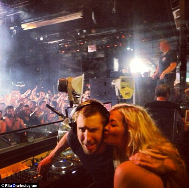 With her squeeze: Rita uploaded a cute snap of herself kissing Calvin's cheek as she hung out in the DJ booth