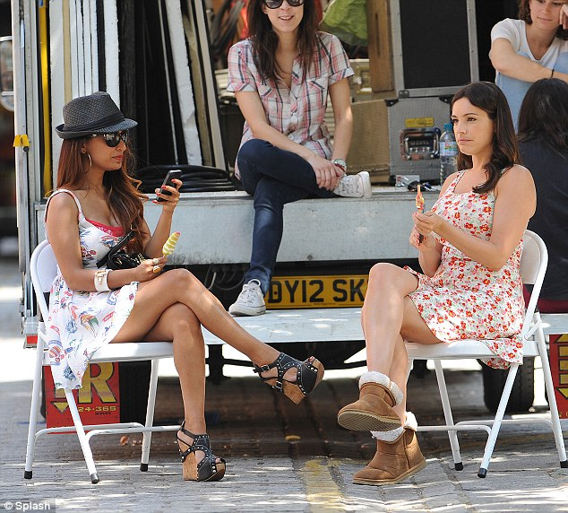 Taking a break: Kelly Brook with close pal Preeya Kalidas on the set of new movieTaking Stock
