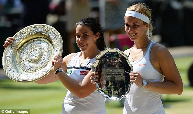 LONDON, ENGLAND - JULY 06:  Marion Bartoli of France poses with the Venus Rosewater Dish trophy next to Sabine Lisicki