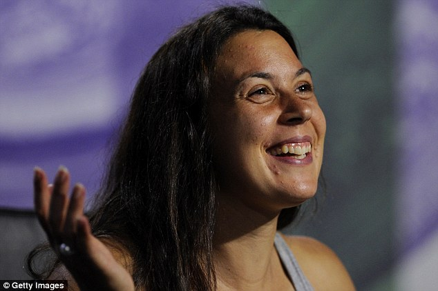 LONDON, ENGLAND - JULY 06:  Marion Bartoli of France smiles as she speaks to members of the media at a press conference