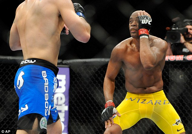 Come and get me: Silva taunts Weidman as he playfully covers up one eye