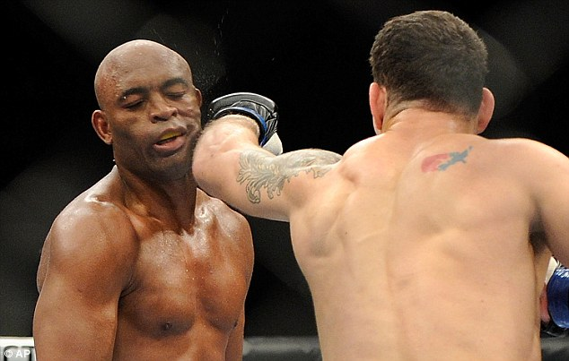 Champion ousted: Chris Weidman connects with Anderson Silva during their UFC 162 middleweight fight
