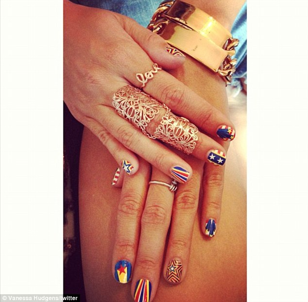Holiday nails: 'oh snap. Happy 4th nails. usa!' Vanessa tweeted on Thursday