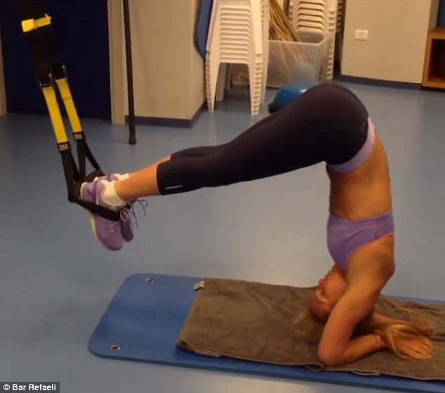 Unconventional: Bar used yoga-like poses to balance with the help of foot straps