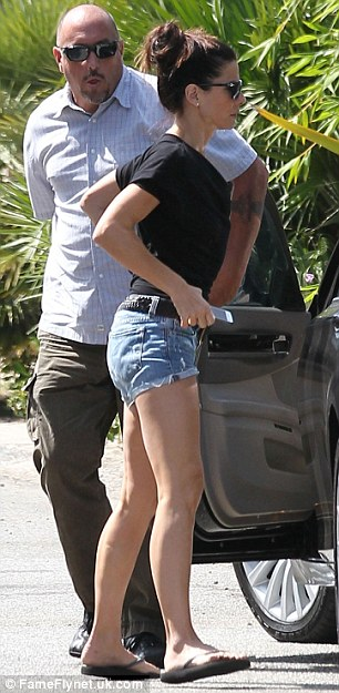Casual: The Miss Congeniality star opted for a simple summery look in a T-shirt and cut-off shorts
