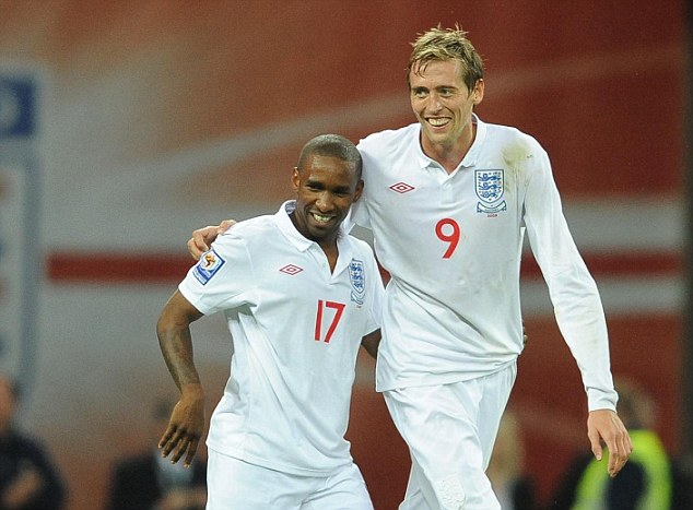 Little and large: Defoe and Peter Crouch have played together for Spurs, Portsmouth and England