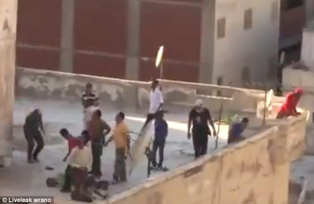 Attack: The boy does not move as the men close up on him and begin beating him
