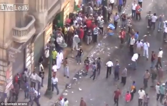 Nowhere to run: The group on the roof was only a small part of the large Morsi-supporter mob which had chased the boys into the building in Alexandria