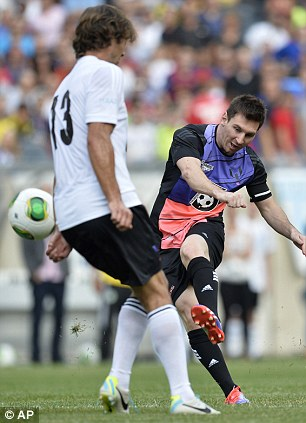 Taking aim: Messi pleases the fans as he finds range with a long distance shot