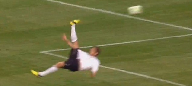 Head over heels: Eliason connects with his stunning overhead kick...