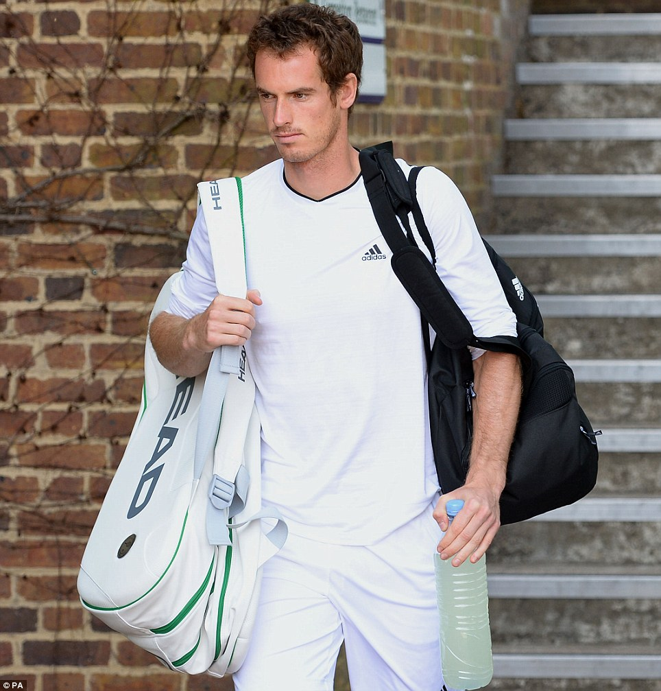 Getting prepped: Andy Murray arrives for a training session on the practice courts at The All England Lawn Tennis and Croquet Club