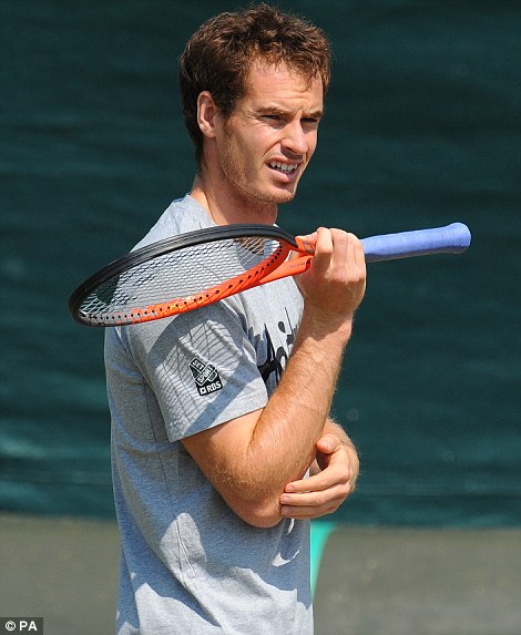 Getting prepped: Andy Murray during a training session on the practice courts at The All England Lawn Tennis and Croquet Club