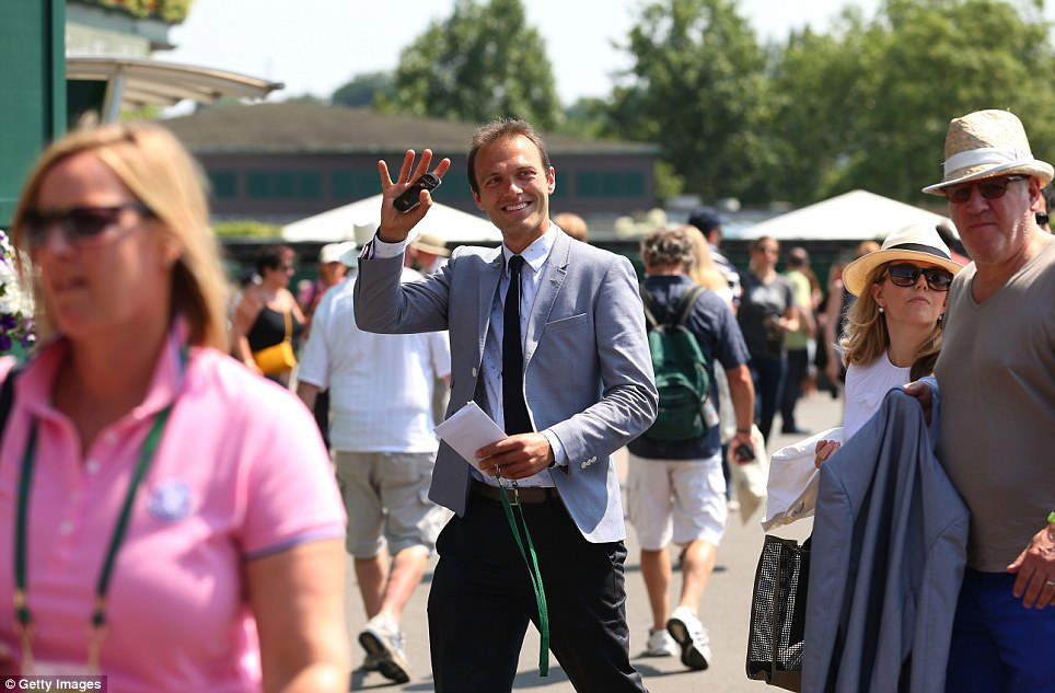 Support: Tennis player and close friend of Andy Murray, Ross Hutchins, waves as he walks through the crowds at Wimbledon ahead of the final