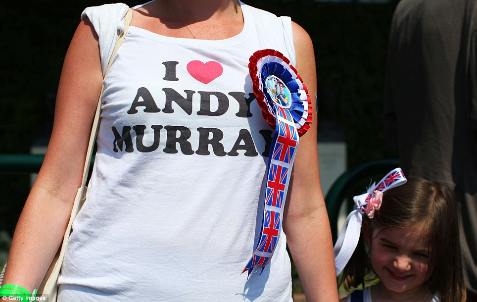 Special print: A tennis fan wears a t-shirt with the logo 'I Heart Andy Murray' and rosette with the tennis star's picture on it