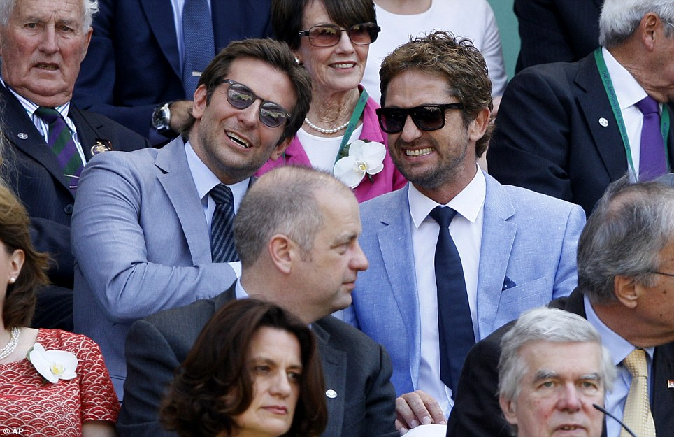Hollywood heartthrobs: Actors Gerard Butler, right, and Bradley Cooper watching the Men's singles final match between Andy Murray and Novak Djokovic